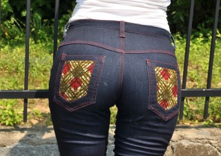 Folake Flared jeans ankara print pocket detail